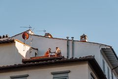 Unidentified couple dinning in a roof in Florence. Florence, Italy - August 23, 2016: Unidentified couple dinning in a roof in Florence, Tuscany, Italy Europe royalty free stock image