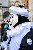 An unidentified couple of man and woman wear Pierrot fancy dresses with black and white beret during Venice Carnival Stock Image