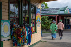 An unidentified couple walk together in Nimbin. Royalty Free Stock Image