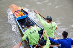 Unidentified crew in traditional Thai long boats compete during Country cup Royalty Free Stock Photography