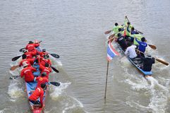 Unidentified crew in traditional Thai long boats compete during Country cup Royalty Free Stock Images