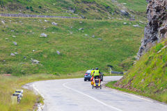 Unidentified cuple of cyclists going to road in Fagaras Mountain, Romania Royalty Free Stock Image