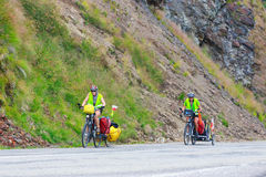 Unidentified cuple of cyclists going to road in Fagaras Mountain, Romania Stock Photography