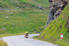 Unidentified cuple of cyclists going to road in Fagaras Mountain, Romania. Stock Images