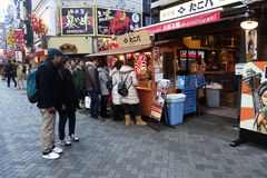 Unidentified customers queue to buy takoyaki in Osaka Stock Photos