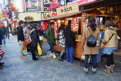 Unidentified customers queue to buy takoyaki in Osaka Stock Photography