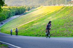 Unidentified cyclist cycling uphill Royalty Free Stock Photography