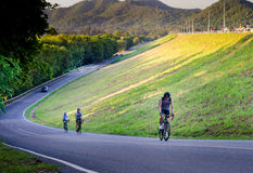 Unidentified cyclist cycling uphill Royalty Free Stock Photos