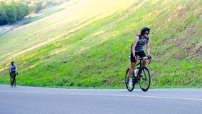 Unidentified cyclist cycling uphill Stock Image