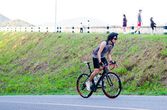 Unidentified cyclist cycling uphill Royalty Free Stock Images