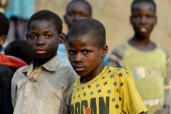 Unidentified Dagomban boys gather together in the local village. DAGOMBA VILLAGE, GHANA - JAN 14, 2017: Unidentified Dagomban boys gather together in the local royalty free stock photography