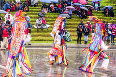 Unidentified dancers with elaborate costume at Inti Raymi, indigenous celebration in Ingapirca, Canar, Ecuador Stock Photo