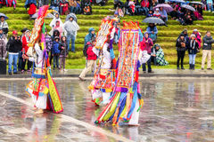 Unidentified dancers with elaborate costume at Inti Raymi,  indigenous celebration in Ingapirca, Canar, Ecuador Stock Photos