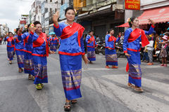 Unidentified dancers perform traditional Thai-Esan dance on the traditional candle procession festival of Buddha. Stock Photos