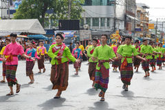 Unidentified dancers perform traditional Thai-Esan dance on the traditional candle procession festival of Buddha. Stock Photo