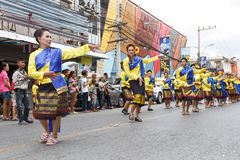 Unidentified dancers perform traditional Thai-Esan dance on the traditional candle procession festival of Buddha Royalty Free Stock Photo