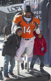Unidentified Denver Broncos fans taken photo with Broncos team uniform on Broadway during Super Bowl XLVIII week in Manhattan Royalty Free Stock Image