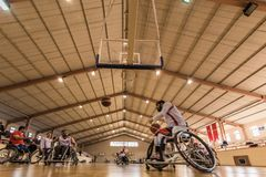 Disabled basketball players have friendly basketball match stock images