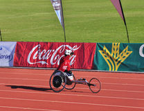 Unidentified disables male,reaching the finish Stock Photos