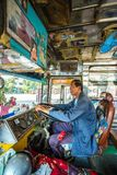 Unidentified driver of an old Thai bus Stock Image