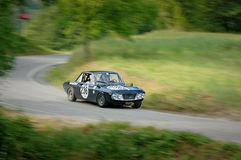 Unidentified drivers on a black vintage Lancia Fulvia racing car Stock Photography