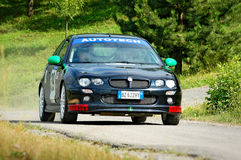 Unidentified drivers on a black vintage MG ZR racing car Stock Image