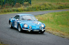 Unidentified drivers on a blue vintage Alpine Renault racing car Stock Photos