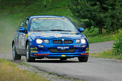 Unidentified drivers on a blue vintage MG ZR racing car Stock Images