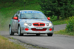 Unidentified drivers on a gray vintage MG ZR racing car Stock Photography