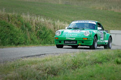 Unidentified drivers on a green vintage Porsche 911 S racing car Royalty Free Stock Image