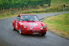 Unidentified drivers on a red vintage Porsche 911 S racing car Royalty Free Stock Image