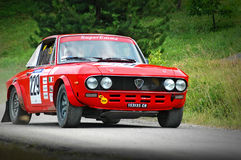 Unidentified drivers on a vintage Lancia Fulvia racing car Stock Photography