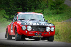 Unidentified drivers on a vintage Lancia Fulvia racing car Stock Images
