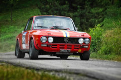 Unidentified drivers on a vintage Lancia Fulvia racing car Royalty Free Stock Image