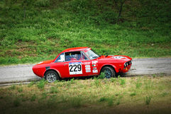 Unidentified drivers on a vintage Lancia Fulvia racing car Royalty Free Stock Photos