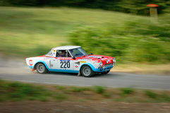 Unidentified drivers on a white, blue and red vintage Fiat Abarth racing car Royalty Free Stock Photography