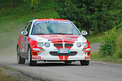 Unidentified drivers on a white and red vintage MG ZR racing car Royalty Free Stock Photography