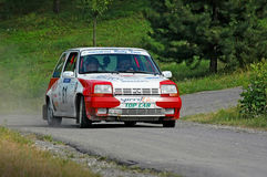 Unidentified drivers on a white and red vintage Renault 5 racing car Royalty Free Stock Photo