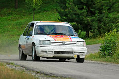 Unidentified drivers on a white vintage Peugeot 309 racing car Stock Photo