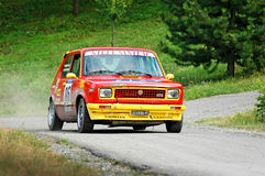 Unidentified drivers on a yello and red vintage Fiat 127 racing car Royalty Free Stock Photos