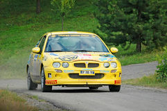 Unidentified drivers on a yellow vintage MG ZR racing car Royalty Free Stock Image