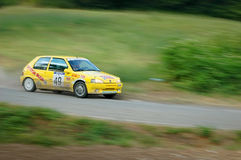 Unidentified drivers on a yellow vintage Peugeot 105 racing car Stock Photos