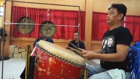 Unidentified  drummer beating drum in Chinese `Kong Tek` rite stock video footage