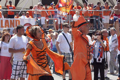 Unidentified Dutch fans in a flamboyant costumes royalty free stock images