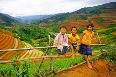Unidentified ethnic kids relaxing on the mountain Royalty Free Stock Photo