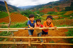 Unidentified ethnic kids relaxing on the mountain Stock Photography