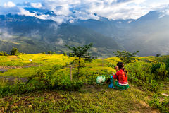 An unidentified ethnic woman sitting on her terraces Stock Images