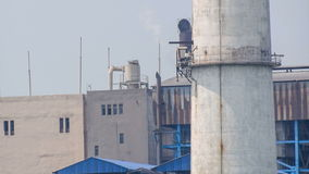 Unidentified factory chimney emitting gas in air, polluting environment stock footage