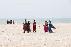 Unidentified family woman man child taking a walk at beautiful sunny morning at Danushkodi beach. Pilgrims from Rameswaram. stock images