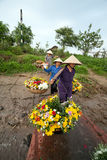 Unidentified farmers carry flowers to the market Royalty Free Stock Image